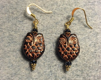 Black with copper wash Czech glass owl bead earrings adorned with black Chinese crystal beads.