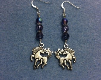 Silver unicorn charm dangle earrings adorned with purple Czech glass beads.