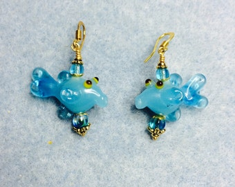 Turquoise lampwork fish bead dangle earrings adorned with turquoise Czech glass beads.