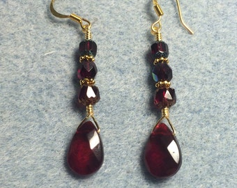 Ruby red briolette dangle earrings adorned with ruby red Czech glass beads.