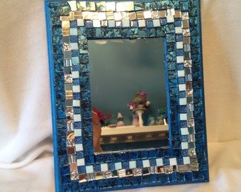 Blue tiled mirror or picture frame.