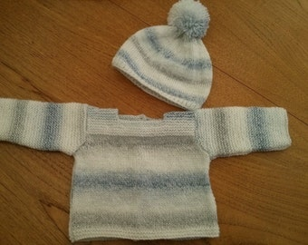 Baby jumper and bobble hat. 0-3 months