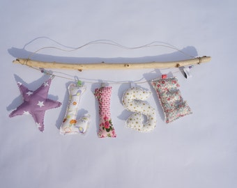 Garland first name letters in fabric padded to suspend and bib