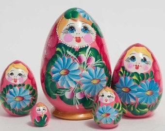 esting Eggs Camomiles blue on pink matryoshka egg - kod61p
