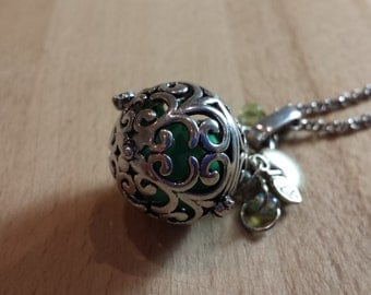 Pregnancy silver brass antique motif scrolls with charms Apple and green beads.