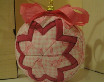 Breast cancer quilted ornament.