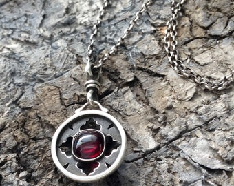 Garnet and Sterling Silver Domed Back Pierced Pendant