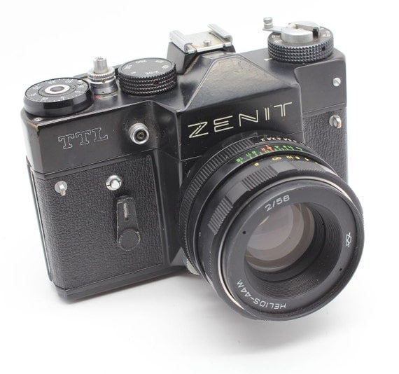 Zenit TTL 35mm SLR camera with lens and ever-ready case     GC and