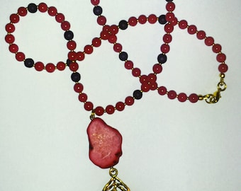 Gemstone necklace with a golden leaf