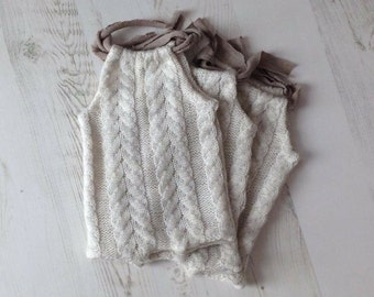 Knitted newborn romper