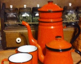 pretty orange, vintage enamelware, graniteware coffee and tea pot with cups.