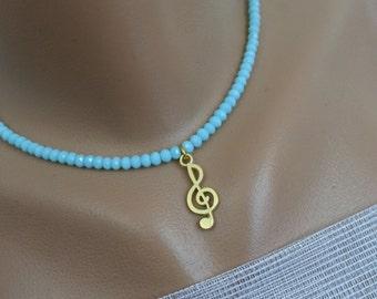 Magical Blue Music..Golden left key & Ice blue mat beads...