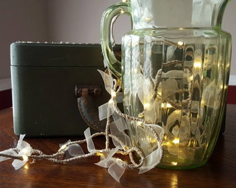 Twine wrapped l.e.d. Lighted wire with ivory organza bow accents