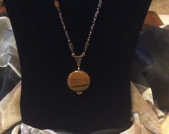 Tiger iron pendant on shiny bronze chain with tiger eye accent pieces