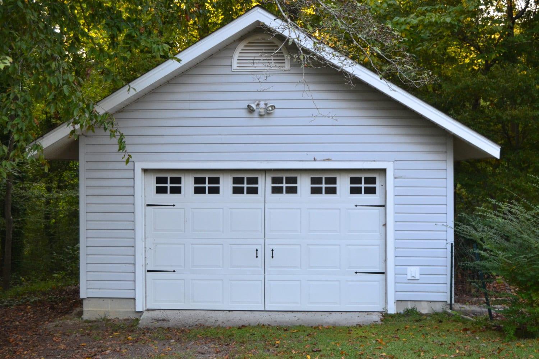 Vinyl faux carriage garage door for Wind code garage doors