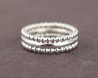 plain silver ring with beads edges