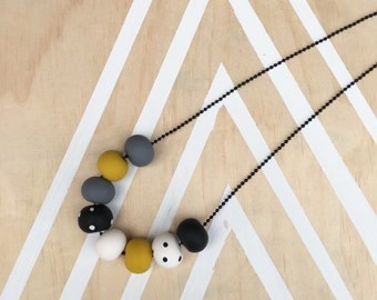 Polymer clay bead necklace, black white spot with mustard