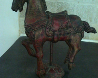Horse carousel in old wood