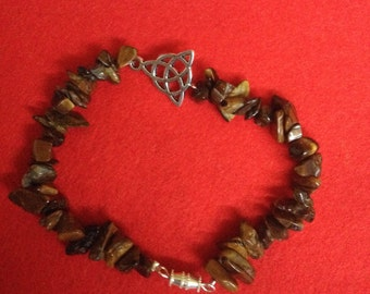 Handmade tigers eye chip bracelet with triquetra pendant with barrel clasp.