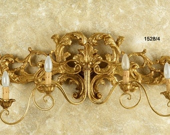 4 Sconce lights, hand-carved wooden decorated in gold leaf.