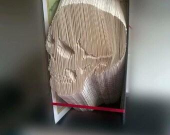 Book folding art pattern for a skull