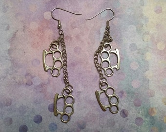Brass knuckle dangle earrings