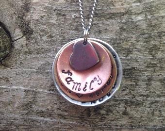 Handstamped family name domed necklace