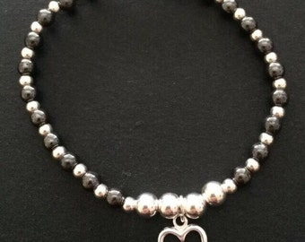 Sterling Silver and black hematite beaded stretch bracelet with sterling silver cut out heart charm uk
