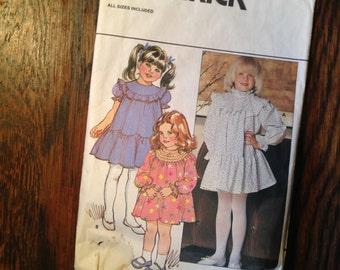 "Butterick #4676 Children's Dress Breast 21-25""  Pre-owned, cut."