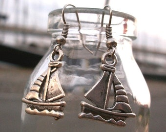 Sailboat earring, silver color, also called ear clip