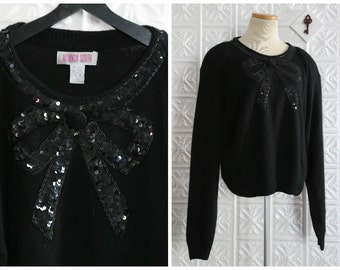 Black Angora Blend Sweater with Sequin Bow Embellished Neckline