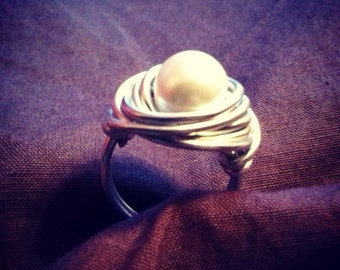 Wire wrapped ring with glass pearl
