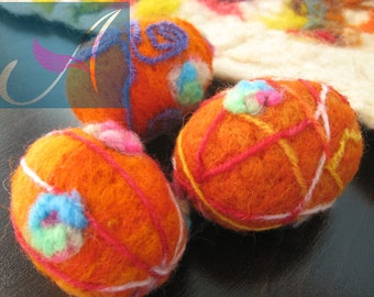Set of three Easter eggs/wool sculpture/needle felting /Easter simbol / unique / warm colors / collectible /wonderful flowers