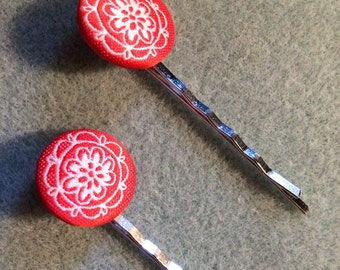 Stitched button hairpins