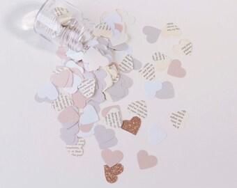 Paper confetti, book page confetti, heart cutouts,