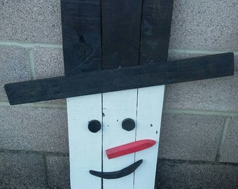 Snowman made from 100% reclaimed pallet wood.