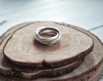 Trinity ring .925 Silver texture (stone, lava) Cartier