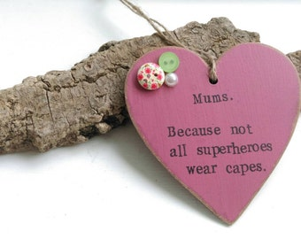 Hanging heart with the words 'Mums. Because not all superheroes wear capes' on