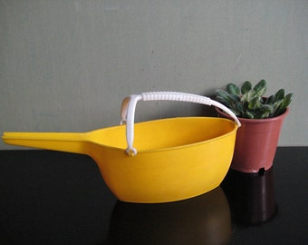 vintage plastic watering can for indoor plants