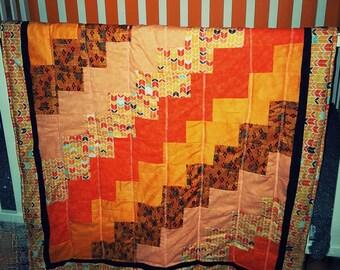 Avalanche of orange baby quilt