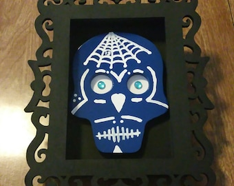 Blue Sugar Skull Mounted In A Black With Shadow Box