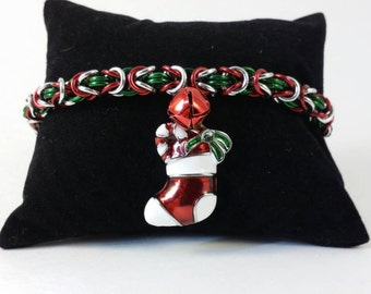 Stocking charm on a byzantine weave chain maille bracelet