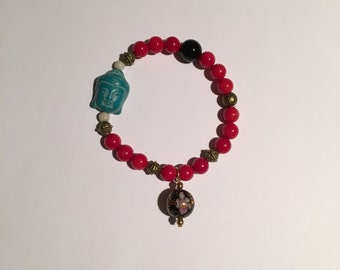 Beaded dyed red coral and black glass bracelet