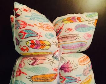 Crayon feathers crib pillow set