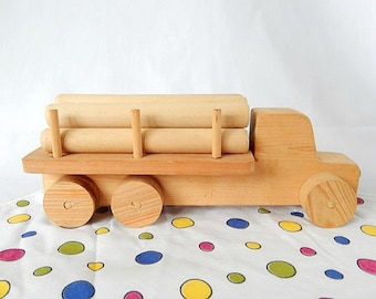 vintage wooden toy truck, hand-built, 1980's, eco friendly toy, log truck, sturdy, children, playtime,  vintage toy