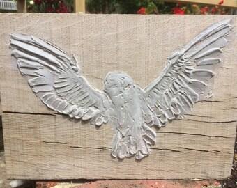 Beautiful bird relief sculpture on oak block
