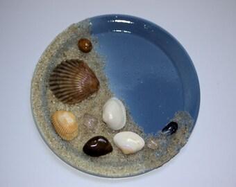 Handmade sea shells and sand magnet
