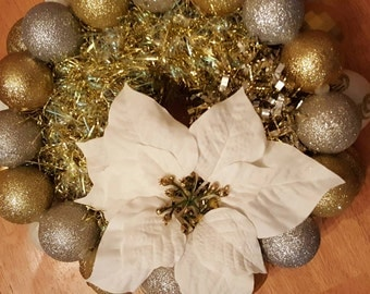 White and gold Christmas ornament centerpiece