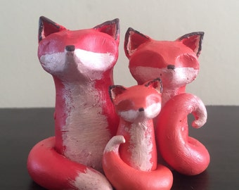 Parent Foxes and Kit