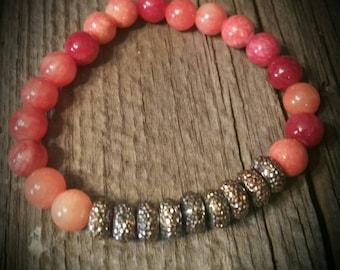 Coral orange stretch bracelet with brass sparkle beads